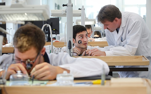 Watchmaking apprentices at work
