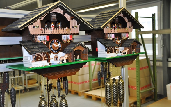 Two typical Swiss cuckoo clocks next to each other