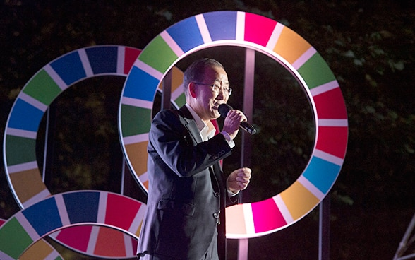 The UN Secretary General, a South Korean national, speaking into a microphone