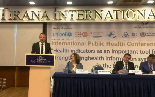 Swiss Ambassador Graf speaking about health information at the public health conference in Tirana