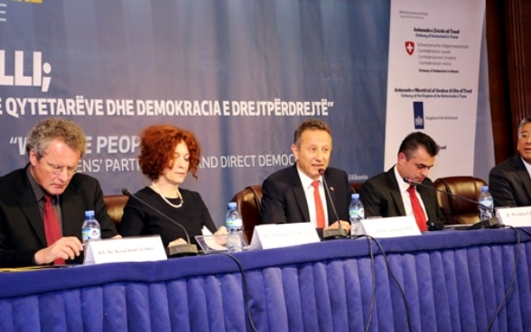 Swiss Ambassador Christoph Graf with other international representatives addressing the conference on direct democracy.