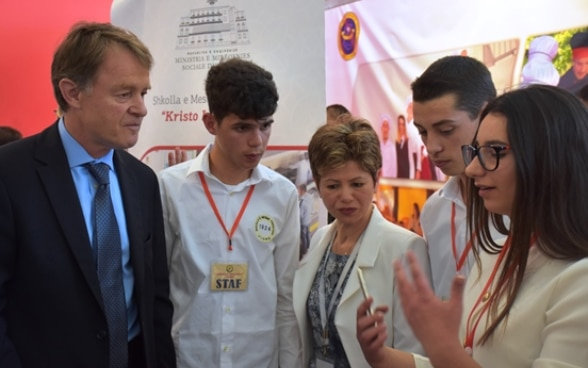 SDC Director Manuel Sager with vocational students at the Skills Fair in Tirana, Albania.