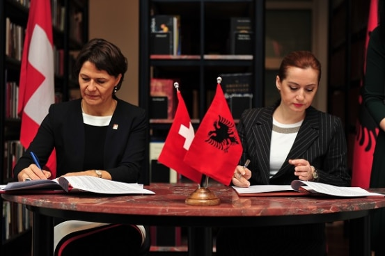 Ambassador Ruth Huber with Albania's Deputy Prime Minister Senida Mesi signing two project agreements.