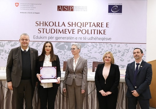 Swiss Ambassador in Albania Adrian Maître (left) handing out certificates to graduates of the Academy of Political Studies.