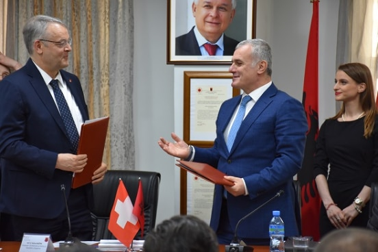 Swiss Ambassador in Albania Adrian Maître (left) after signing agreement on new assistance with the Head of Albania's Supreme State Audit Bujar Leskaj.