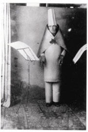 Hugo Ball in costume at the Cabaret