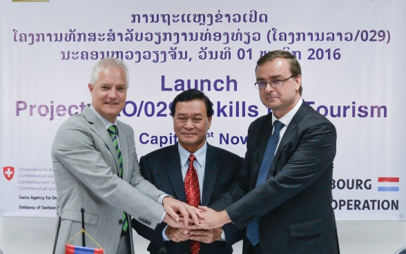 Dr Kongsy Sengmany, Vice Minister of Education and Sports, together with Mr Claude Jentgen, Chargé d'Affaires, Embassy of Luxembourg in Lao PDR, and Mr Tim Enderlin, Mekong Regional Director, Swiss Agency for Development and Cooperation (SDC) at the Skill for Tourism signing ceremony.