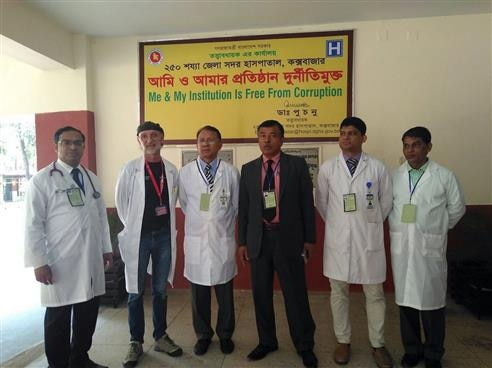 SHA expert posing for a photo with medical staff.