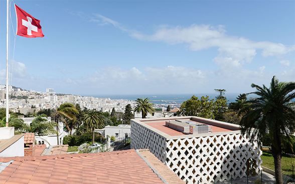 View of the Swiss embassy in Algiers with the city and the sea in the background