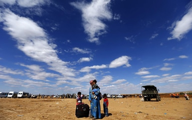 Syrian refugees at the border between Syria and Turkey.