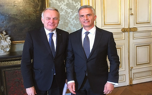 Didier Burkalter and Jean-Marc Ayrault standing