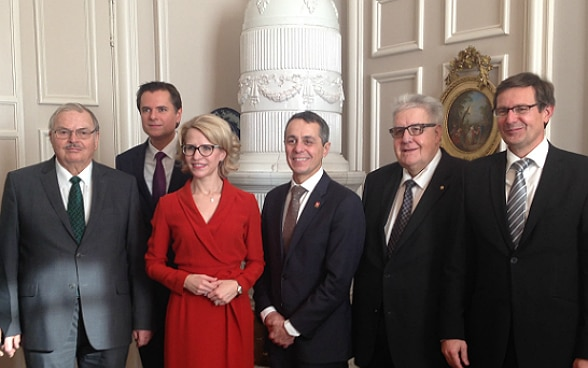 Federal Councillor Ignazio Cassis poses for the picture with Liechtenstein's Foreign Minister Aurelia Frick.
