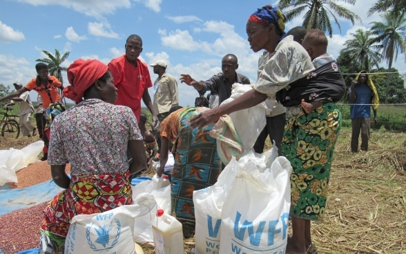 People share bean rations at a UN World Food Programme distribution site in the crisis-ridden Congolese region of Kasai.