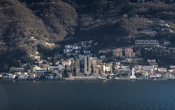 View of the village Campione d'Italia. It lies on the shore of a lake on a mountain slope.
