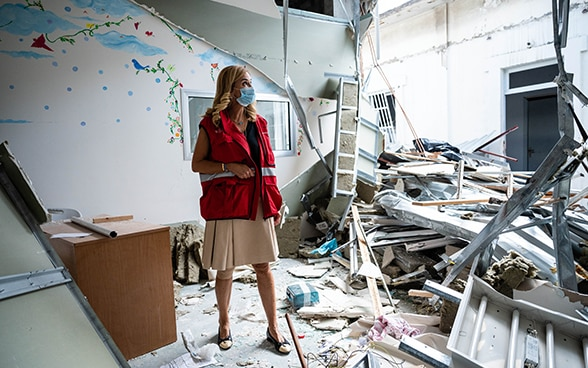 The Swiss Ambassador Monika Schmutz Kirgöz visits a destroyed hospital.