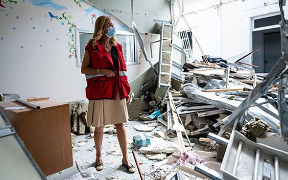 Ambassador Monika Schmutz Kirgöz in a hospital destroyed in the Beirut explosion last August.