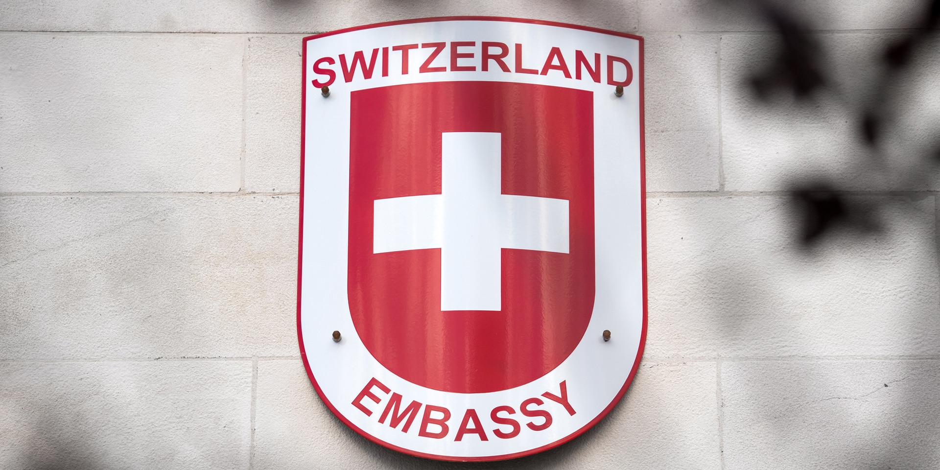 "Sign that reads ""Switzerland Embassy""."