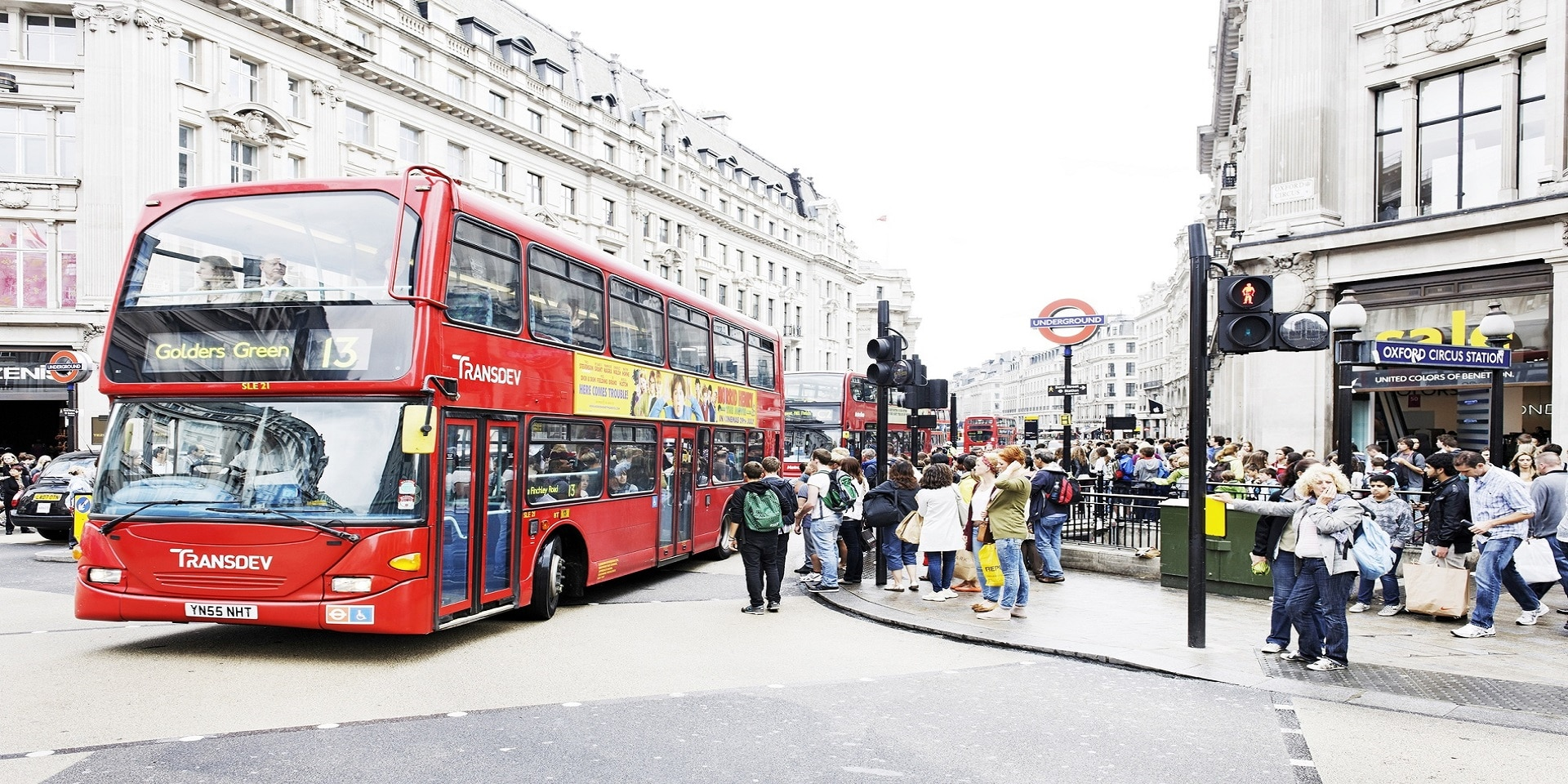 A classic red London bus at Oxford Circus.