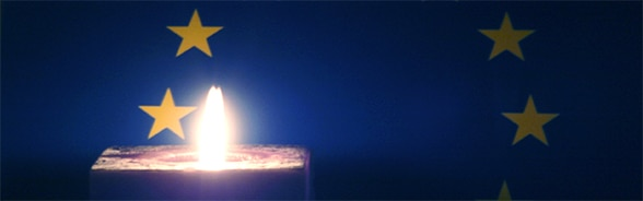 Image of a candle flame and the European flag, representing promotion of human rights
