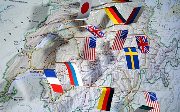 Map of Switzerland with several international flags