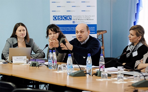 Image of people at a meeting during an OSCE mission in Moldova