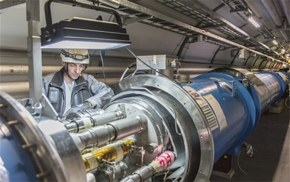 A man working on CERN's LHC particle accelerator in Geneva