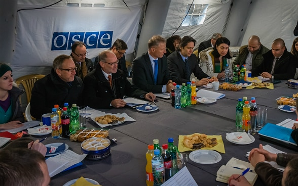 Swiss OSCE representatives lead a meeting of Russian, South Ossetian and Georgian delegations in a tent near the administrative boundary line at Ergneti Georgia.