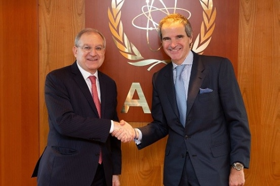 Ambassador Benno Laggner, Permanent Representative of Switzerland to the IAEA and CTBTO, shaking hands with IAEA Director General Rafael Grossi.