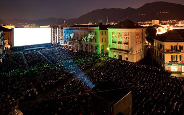 Open-air cinema in Locarno in the evening with thousands of visitors