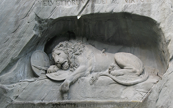 The lying stone lion of the Lion Monument in Lucerne