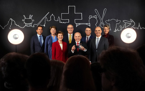 The Swiss Federal Council 2019 (left to right): Federal Chancellor Walter Thurnherr, Federal Councillor Viola Amherd, Federal Councillor Simonetta Sommaruga (vice-president of the Federal Council), Federal Councillor Guy Parmelin, President of the Confederation Ueli Maurer, Federal Councillor Ignazio Cassis, Federal Councillor Alain Berset, Federal Councillor Karin Keller-Sutter.