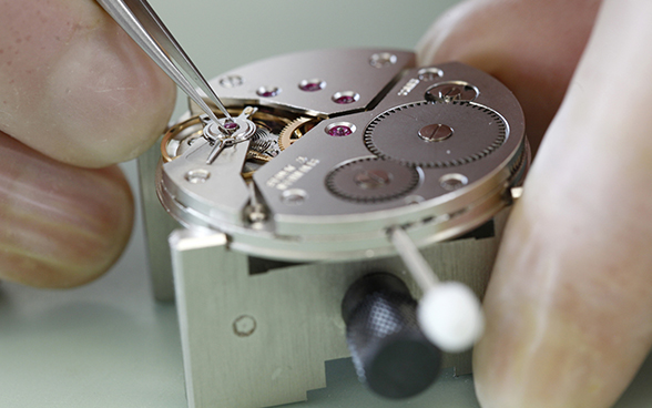 Mechanical wristwatch being repaired