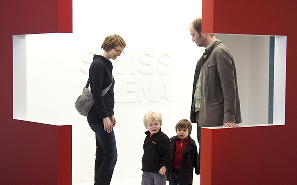 Family viewing an exhibition