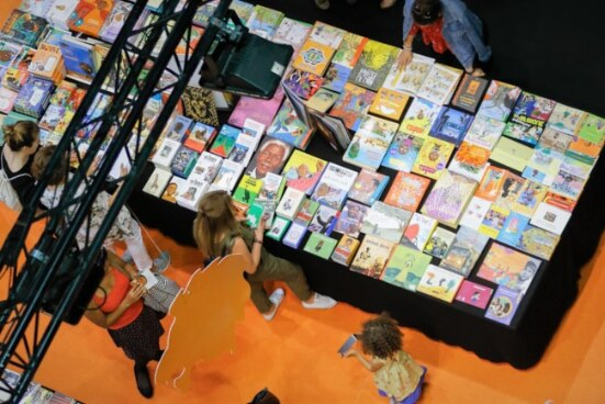 A stand at the African Book Fair, where publishers present and sell African literary works to the public.