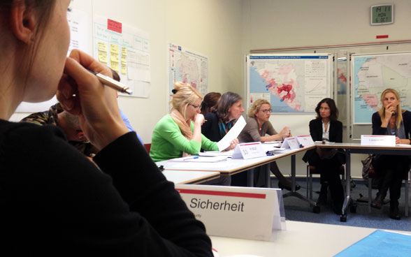 In Köniz, participants attend a meeting of the Swiss Humanitarian Aid's operations management for Ebola.