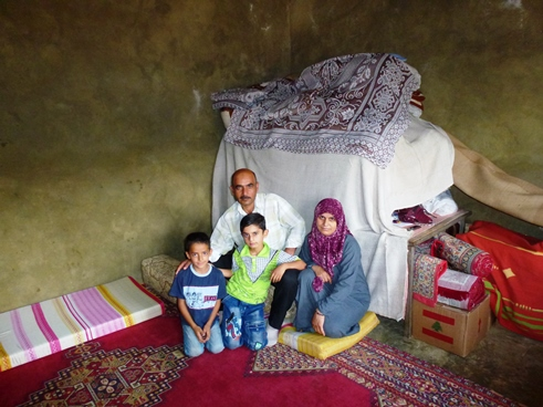 A Syrian family in temporary accommodation with a Lebanese family in the village of Kfartoun in the Akkar district on the Lebanese-Syrian border.