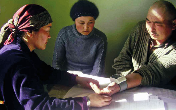"In the ""Community Action for Health"" project in Kyrgyzstan, villagers learn how to prevent illness."