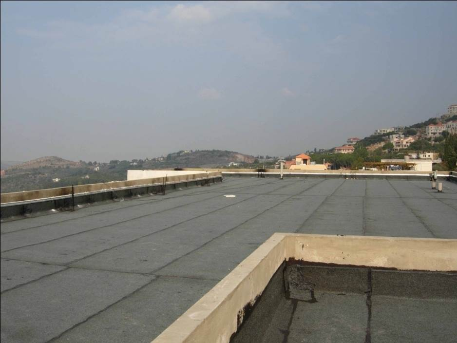 A freshly asphalted roof stops water getting in.