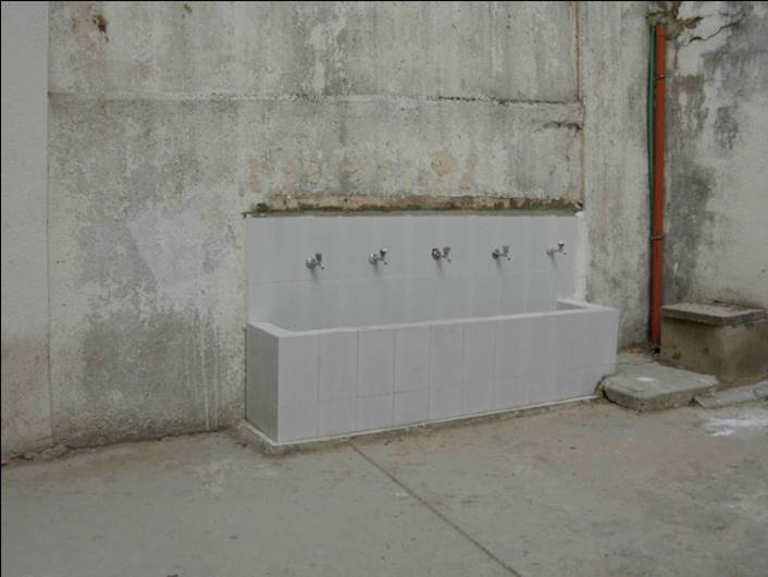 A newly rebuilt sink with five taps.