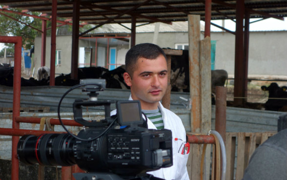 The photo shows Giorgi, a trained veterinary assistant in Dedoplistskaro looking at the cameraman.