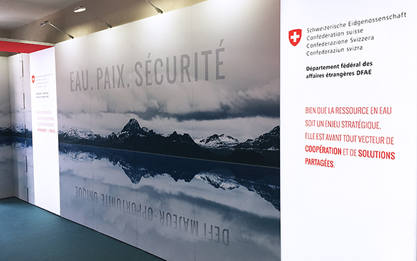 A large panel depicting a mountainous landscape. The words WATER.PEACE.SECURITY are written on it in large format.