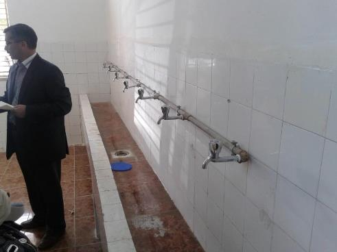 a man standing in front the new taps