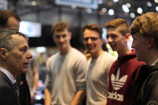Federal Councillor Ignazio Cassis talks to young people at the 89th International Motor Show in Geneva on March 7, 2019.