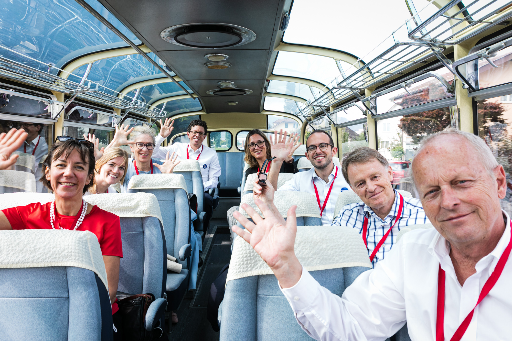 "Swiss ambassadors greet from the ""Meet the Ambassadors"" bus."
