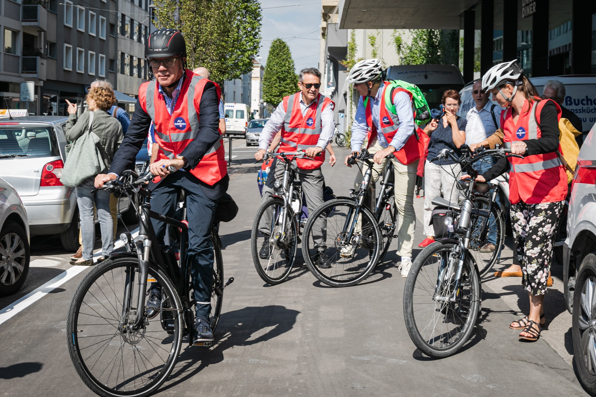 Swiss ambassadors on e-bikes.