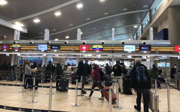 At Mariscal Sucre International Airport on April 3, passengers on the Quito-Zurich flight check-in.